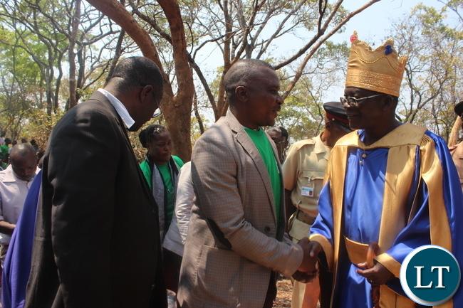 Chiefs and Traditional Affairs Deputy Minister John Kufuna (Middle) congratulates Chief Ngabwe VI (right) after his coronation as Kapiri Mposhi MP Eddie Musonda looks on.