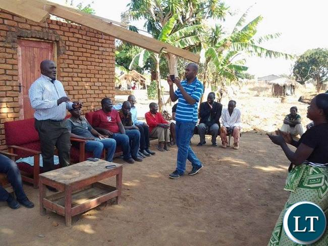 Lundazi business executive Evans Ngoma addressing women at Tikolane Women Club (not in picture) in Lundazi