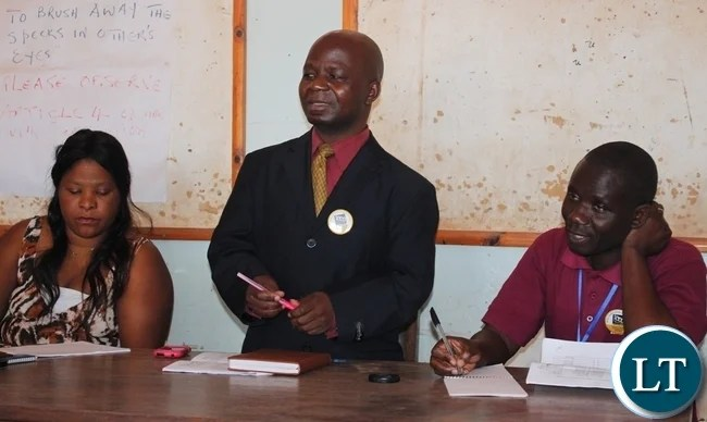 Acting Mbala District Administratice Officer, Fredrick Chilambwe officiating at the Stakeholders' Participatory Performance Review and Reflection meeting for Action Aid at Tutenzi Lodge in Mbala