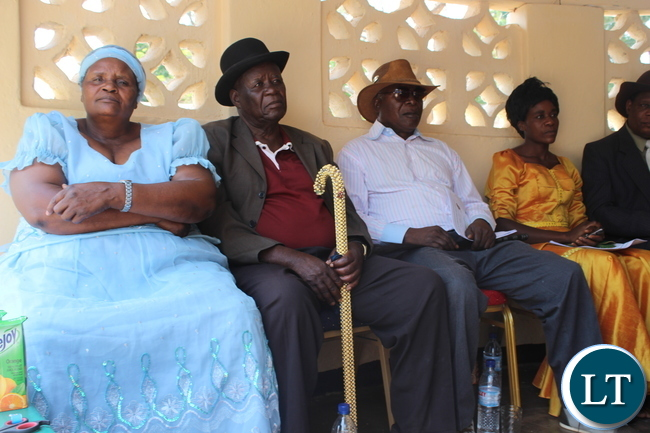 """Chiefs Hamusonde( Right in white shirt and brown hat) and Monze (left in brown t-shirt and black hat) were among some of the invited guests at the Zambia College of Agriculture's (ZCA) 4th Diploma and 64th Certificate General Agriculture graduation ceremony held under the theme, """"Continued Innovation and Quality Agriculture Training Beyond the Golden Jubilee Year"""" , in Monze"""