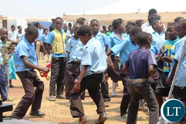 DWANKHOZI Primary school pupils dance to express their excitement during the handover of a health post by Japan Tobacco International (JTI) to the community in the area