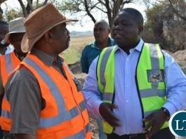 Zambia's Transport, Works, Supply and Communication Minister Yamfwa Mukanga (right) and Botswana Minister for Transport and Communications Tshenolo Mabeo (left) during an inspection of Kazungula Bridge project