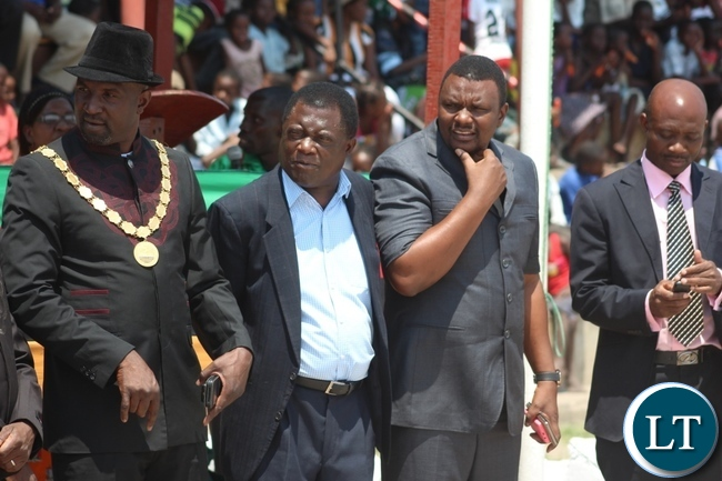 Mongu Mayor Bright Tombi (l), Mongu District Commissioner Susiku Kamona (c) and Western Province Deputy Permanent Secretary Bernard Chomba (r) waiting for the arrival guest of honour Labour Minister Fackson Shamenda to officiate the 51st Independence Anniversary celebrations at Mongu Sports Stadium