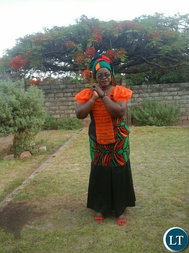 A kabwe woman Mrs Alinat Adorah Phiri clad Zambian flag colours declaring her readiness to join the nation in prayer and fasting