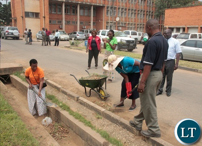 Ministry of information and Broadcasting Service staffs cleaning during the relaunch of KEEP ZAMBIA CLEAN at Mass media