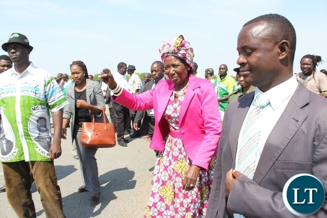 Vice President Inonge Wina (c) on arrival at Mongu Airport to officiate at the Inonge Wina Independence Football Championship Tournament in her constituency in Nalolo District
