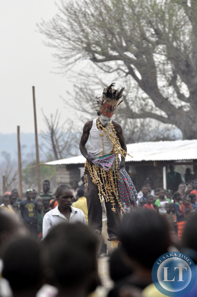A local village entertainer fondly known as 'Chamokoka' entertains guests at the Mukulapembe Traditional Ceremony in Luwingu recently
