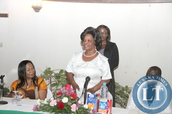 First Lady Esther Lungu speaks at Zambia's Ambassadors residence in Riyadh where she addressed Zambian's Living in Saudi Arabia after a day of Prayer and Fasting on Sunday night, October 18,2015. Looking on are Zambia's Ambassador to Saudi Arabia Ibrahim Mumba and wife -Picture by THOMAS NSAMA