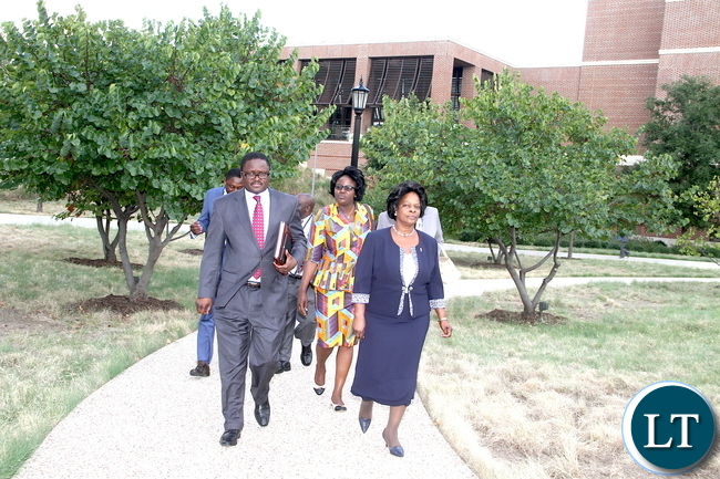 First Lady Esther Lungu flanked by Zambia's Ambassador to the United States  Palan Mulonda leaves after the closing ceremony of the Global Women's Network Summit at George W. Bush Presidential centre in Dallas, Texas on Tuesday, September 22,2015 -Picture by THOMAS NSAMA