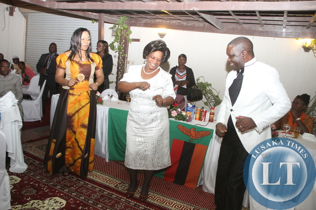 First Lady Esther Lungu with Zambia's Ambassador to Saudi Arabia Ibrahim Mumba and his wife could not resist a Gospel music at Zambia's Ambassadors residence in Riyadh where she addressed Zambian's Living in Saudi Arabia after a day of Prayer and Fasting on Sunday night, October 18,2015 -Picture by THOMAS NSAMA