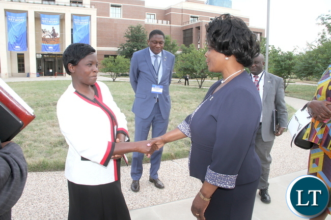 First Lady Esther Lungu congratulates Livingstone based Nurse Joyce Mapani (L) for being one of the panelists  during the Global Women's Network Summit at George W. Bush Presidential centre in Dallas, Texas on Tuesday, September 22,2015 -Picture by THOMAS NSAMA