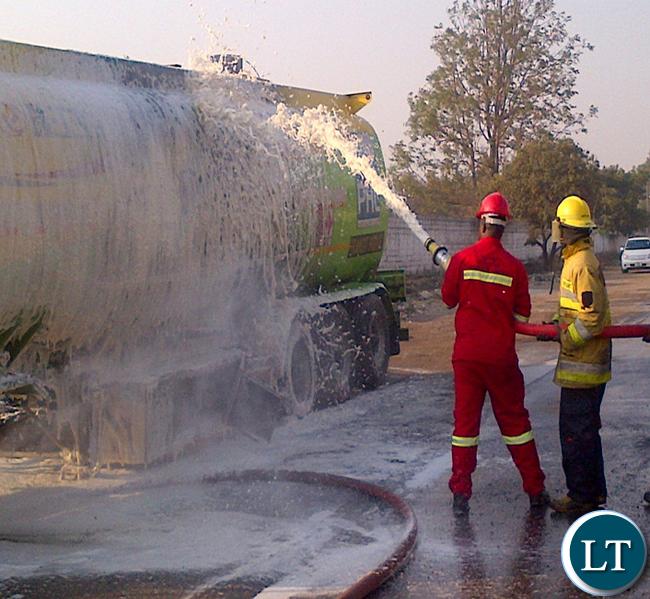 Fire fighters dampen the blaze in a fuel tanker in the industrial area.