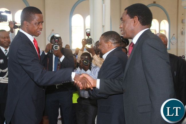 President Lungu greets UPND president Hakainde Hichilema during the memorial service of the Late President Michael Chilufya Sata at St Ignatius Catholic Church in Lusaka