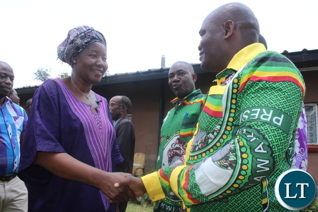 Ms. Nawakwi greets a member after addressing a meeting. President Nawakwi addresses a public meeting in Nkana Constituency