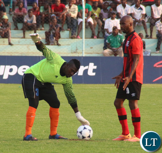 Nkwazi goal Keeper Makaba Kalaba trying some tricks against Henry Banda during the penalty shoot outs