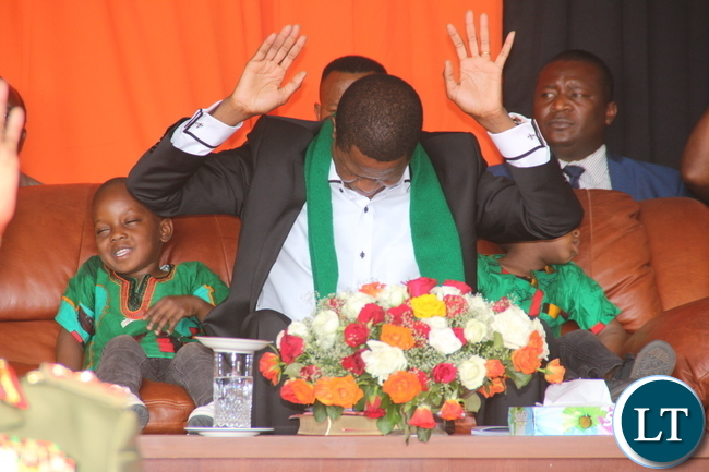 Edgar Lungu during the Fasting and Prayer Church services at Lusaka Showground: praying , mediating and releasing dove