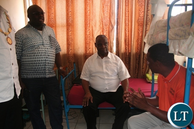 Higher education minister Dr Michael Kaingu (m) seated with North-Western province permanent secretary Amos Malupenga (l) in Solwezi Trades principal Edmond Kambobe during the tour of students' hostels at the learning institution in Solwezi