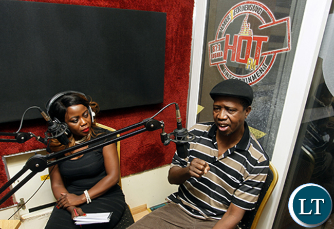 President Edgar Chagwa Lungu (right) speaks during the Hot FM Breakfast show at State House on Saturday,October 10,2015. On the left is HOT FM presenter Hope Chishala. PICTURE BY SALIM HENRY/STATE HOUSE ©2015