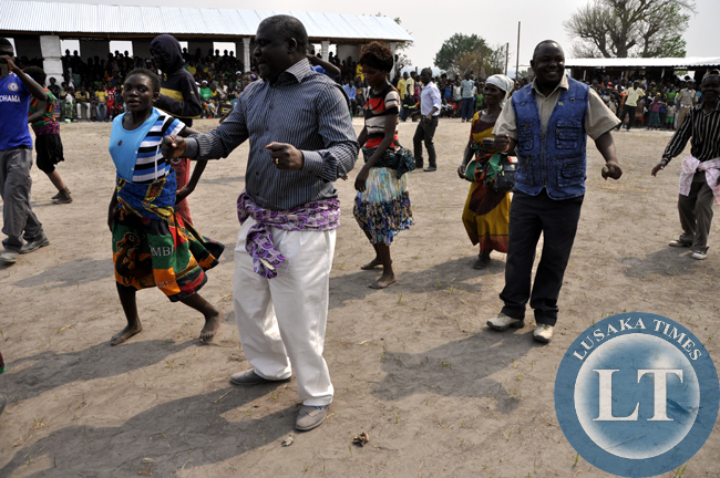 Lupososhi Member of Parliament abel Chungu dances with a troupe during the Mukulapembe Traditional Ceremony in Luwingu recently