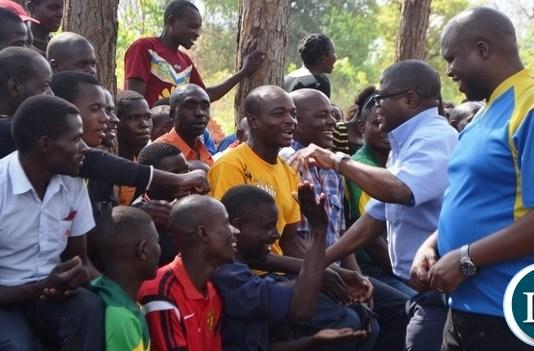 MALOLE MP Christopher Yaluma accompanied by Simon Mwila greets residents at Rosa Mission.Picture by KENNEDY MUPESENI
