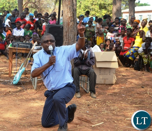 MALOLE MP Christopher Yaluma kneels to thank residents at Rosa Mission for massively voting for President Edgar Lungu .Picture by KENNEDY MUPESENI (1)