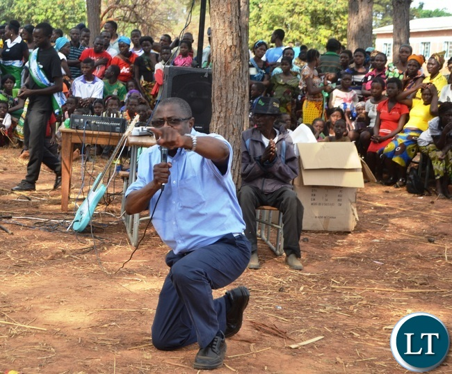 MALOLE MP Christopher Yaluma kneels to thank residents at Rosa Mission for massively voting for President Edgar Lungu .Picture by KENNEDY MUPESENI (3)