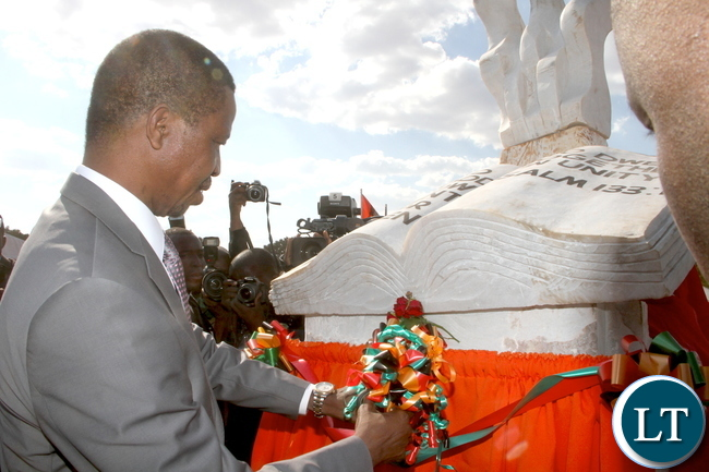 President Lungu cuts a ribbon during the Ground breaking ceremony for the New Cathedral and Interdenominational Thanks Giving Church Service at woodlands reserve forest area in Lusaka on Sunday, October 25,2015 -Pictures by THOMAS NSAMA