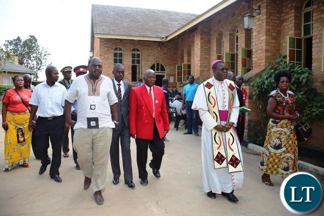 BISHOP of Catholic Diocese of Mansa Rev. Patrick Chisanga leading Deputy Health Minister Dr. Chitalu Chilufya and Mansa District Commissioner Royd Chakaba and other government officials during the National Day of prayers in Mansa