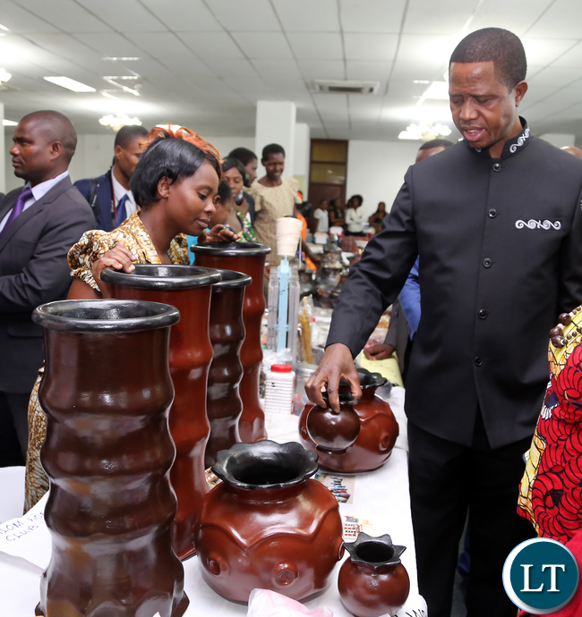 President Edgar Lungu talks to Evelyn Chipili Of Mweese in Luapula Clay Pot maker of Luansya during the exhibition at Mulungushi confrence Centre for the National Women Economic Empowerment Expo, which was Promoting Young Women enterpreneurs as a Change agents for National development . Picture By Eddie Mwanaleza/ Statehouse. 13-10-2015.