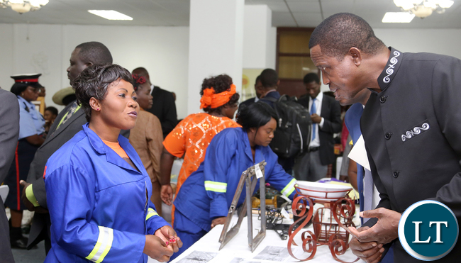 President Edgar Lungu talks to Grace Chibwe a Contractor of Chadiza during the exhibition at Mulungushi confrence Centre for the National Women Economic Empowerment Expo, which was Promoting Young Women enterpreneurs as a Change agents for National development . Picture By Eddie Mwanaleza/ Statehouse. 13-10-2015.
