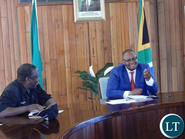 Mr. Emmanuel Mwamba (r) with NCC acting CEO, Mr. Francis Mwape