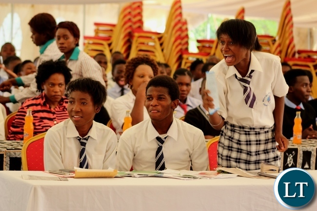 Mule Secondary School pupil Rachael Kandanda (r) reacts during a Competition and Consumer Protection Commission School Clubs debate in Mongu
