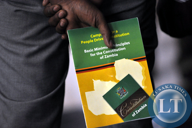A man with a copy of the documentation that had proposals on how best to handle the constitution making process in Zambia