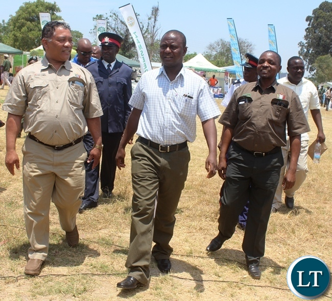 From (left) Agriculture Minister Given Lubinda, Central Province Minister Davies Chisopa and Agriculture deputy Minister Maxas Ng'onga touring stands during the Electronic Voucher launch in Kabwe's Mpima Diary farming Block