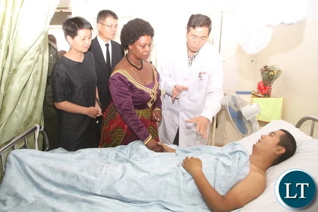 First Lady Esther Lungu with Sinozam Frendship Hospital Chief Medical officer Dr Xi Sheng Qin when she visited two Injured Chinese national admitted to Sinozam Friendship Hospital before attending burial of the three who were murdered on the Copperbelt. This was in Kitwe on Tuesday, November 3,2015-Picture by THOMAS NSAMA