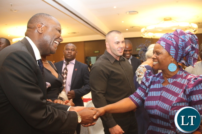 First Lady Esther Lungu greets Lunte MMD member of Parliament Felix Mutati during the Diplomatic Club Gala dinner at InterContinental Hotel in Lusaka on Friday, November 13,2015 -Picture by THOMAS NSAMA