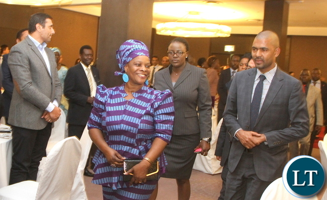First Lady Esther Lungu flanked by Youth And Sports minister Vincent Mwale on arrival at Hotel InterContinental in Lusaka for the Diplomatic Club Gala dinner on Friday, November 13,2015 -Picture by THOMAS NSAMA