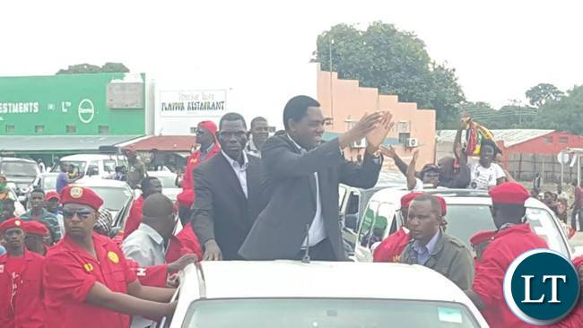 HH gestures to his supporters upon arrival in Mongu