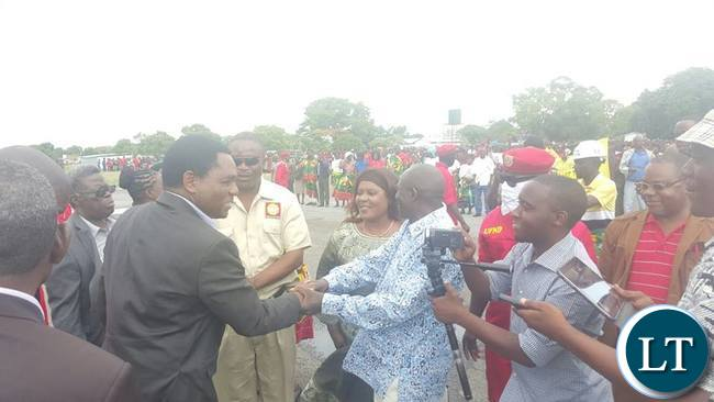 HH greeting officials on arrival at Mongu airport