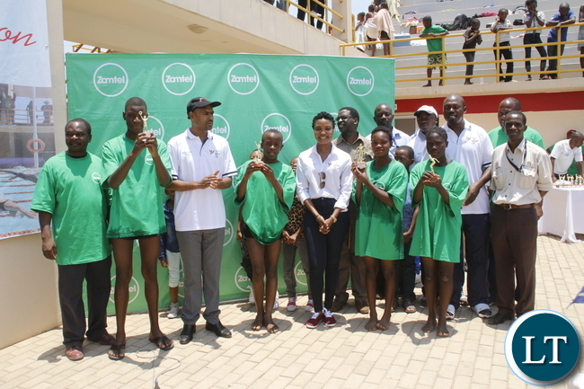 Minster of Youth and Sport Vincent Mwale officiates at the Zamtel Swim Challenge Grand Finale while attending were Zamtel Acting Corporate Communication Manage Patricia Mulenga, OYDC Director Clement Chileshe and participants drawn from OYDC neighborhood at OYDC on Saturday, November 14th, 2015.