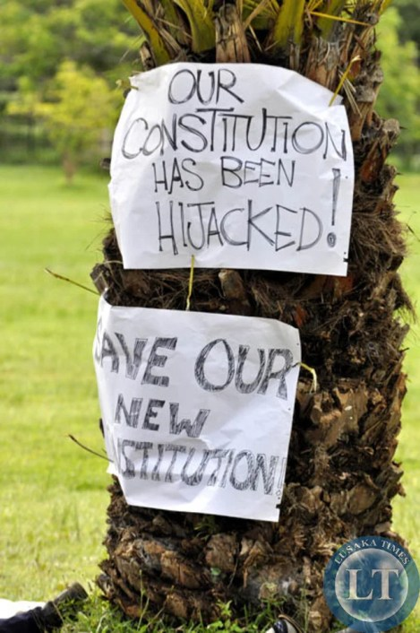 Messages demanding a good constitution pasted on trees outside the Cathedral of the Holy Cross