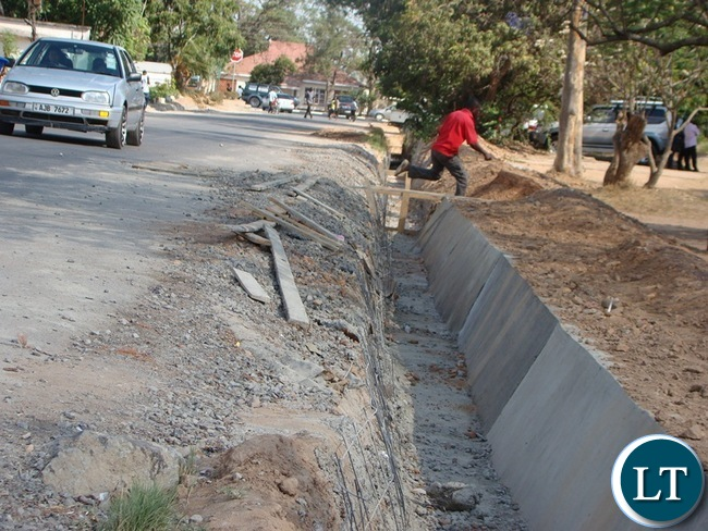 SOME of the roads in Choma district, which is now Southern province Headquarter, have been upgraded to bituminous standard. On the picture the contractor is now working on the drainage system before the onset of the rains.
