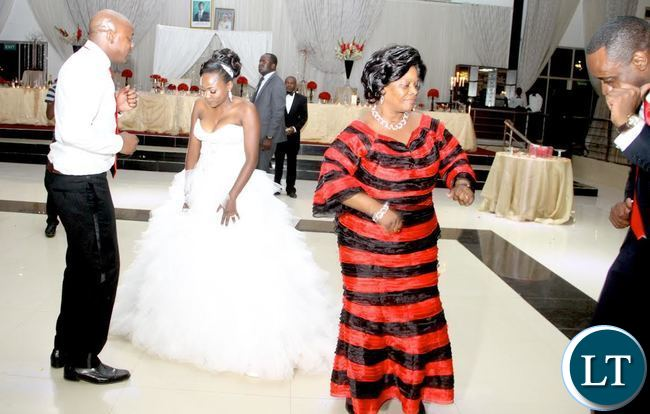 First Lady Esther Lungu take to the Dance floor during a wedding for Former Zambia Army Commander Gen Benjamin Mibenge's son Bweupe (L) and Chifubu PF Member of Parliament Susan Kawandami's daughter Chinyimba at ZAF Chamba Valley Officers' Mess in Lusaka on Saturday, November 14,2015 -Picture by THOMAS NSAMA