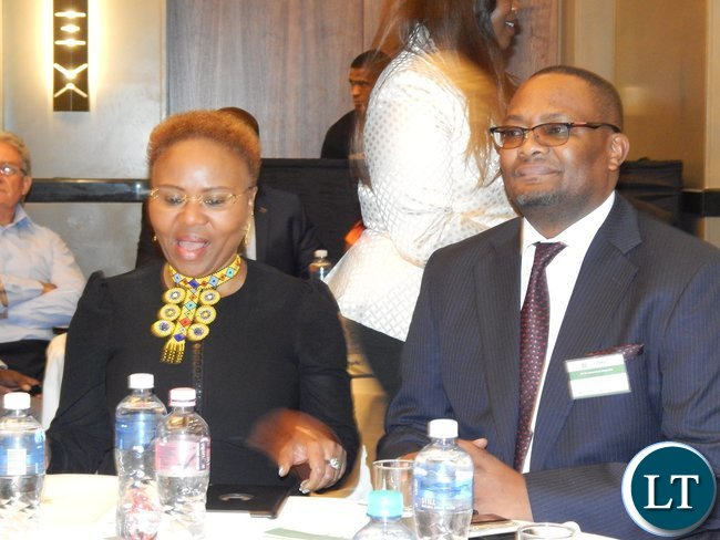 Mr. Emmanuel Mwamba with South Africa's Minister for Small Business Development Ms. Lindiwe Zulu follow deliberations at the launch of the Zambia-South Africa Business Council in Johannesburg on Friday, 30th October, 2015.