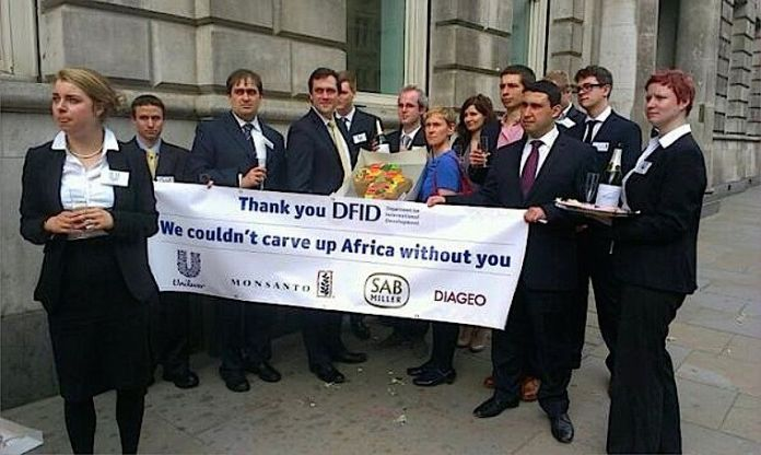 Campaigners protest outside the UK Department for International Development. Photo: WDM