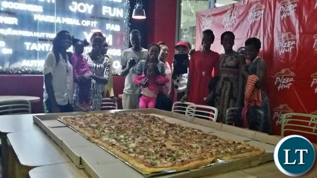 Beauty Shamanga and her team about to devour in the country's largest ever pizza