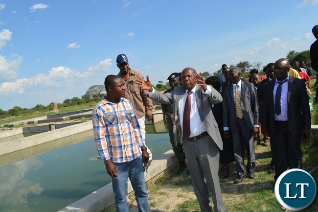 Finance Minister Alexander Chikwanda at Inyambo Community Development Trust where he gave them a loan of K3, 3 million to boost fish production