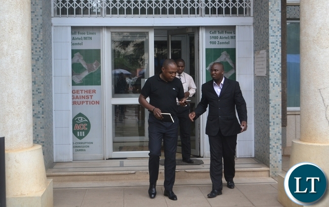 Kalusha Bwalya with ACC investigating officer Emmanuel Mwenge