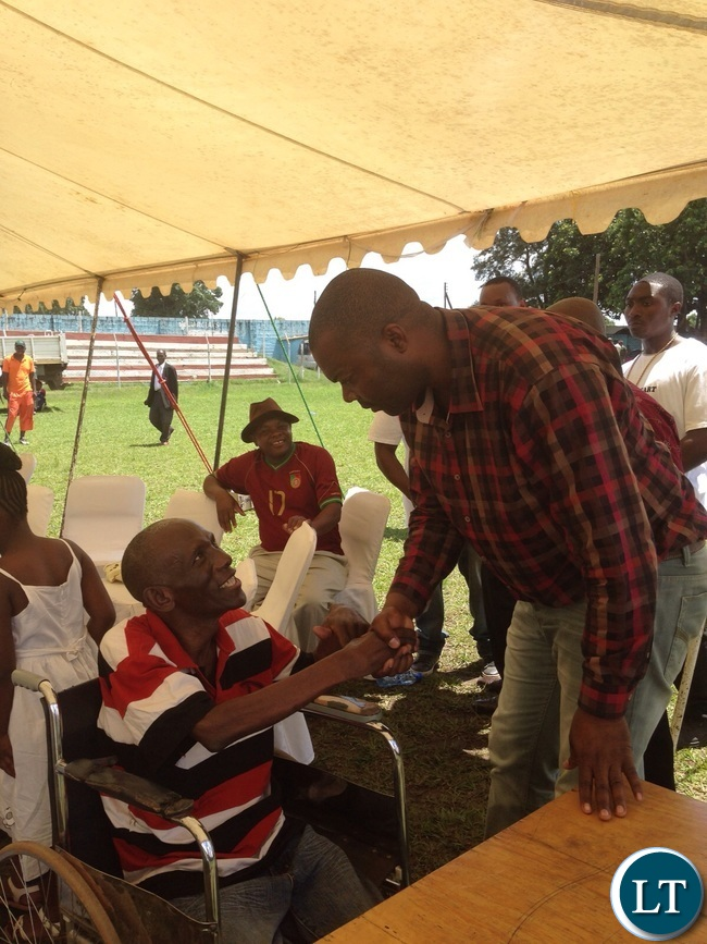 Mr Lusambo shakes hands with one of the receipients