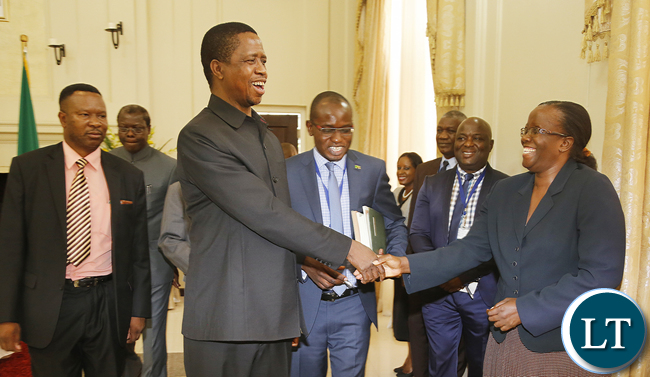 President Edgar Lungu thanks Madam Doris Mwinga clerk of the National assembly the Constitution Amendment bill that was passed by parliament last week. President Edgar Lungu reiterating that he would assent to the document in the first week of January, next year. PICTURE BY EDDIE MWANALEZA/STATEHOUSE . 23-12-2015